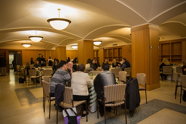 McKim Conference Room with multiple round table set up with people