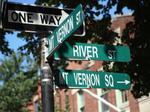A Street sign for the intersection of Mt. Vernon and River Streets, with a sign indicating the way to Mt. Vernon Square.