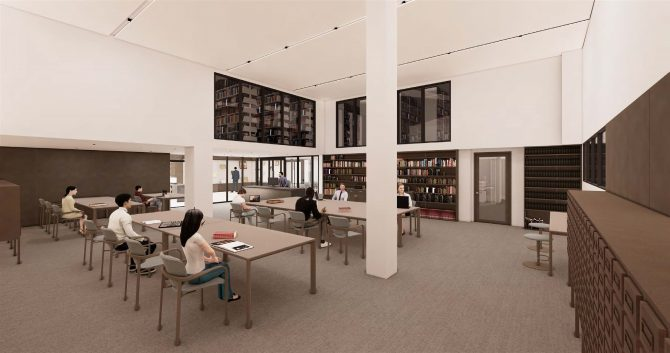 Image displays a classroom with several desks and chairs, with books on shelves around them. There is a glass door to enter the room.
