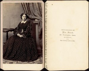 Image of two pages of a book with a portrait photo of a woman sitting in a chair at left.